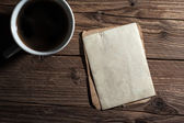 White cup of coffee and old paper — Stock Photo