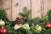 Christmas tree branches with decoration — Stock Photo