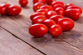 Fresh tomatoes on wood background — Stock Photo