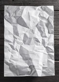 White paper on wood background — Stock Photo