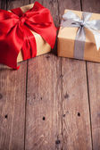 Two gift boxes on wooden background — Stock Photo