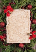 Sheet of paper with christmas decoration — Stock Photo