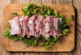 Raw pork ribs on a cutting board — Stock Photo