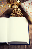 Open book with christmas decoration — Stock Photo