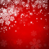 Red christmas background with snow and snowflakes — Stock Photo