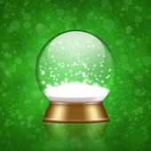 Snow globe with snow inside on bokeh background — Stock Photo