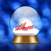 Snow globe with gift box inside on bokeh background — Stock Photo
