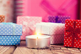 Christmas candle and gift boxes — Stock Photo