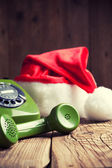 Vintage phone with Santa's hat — Stock Photo