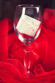 Empty glass with gift box — Stock Photo