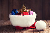 Christmas decoration in Santa's hat — Stock Photo