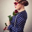 Retro womwith red rose and glasses — Stock Photo #40036839