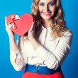 Woman holding heart-shaped box — Stock Photo