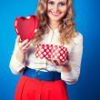Woman holding heart-shaped box — Stock Photo #40037167