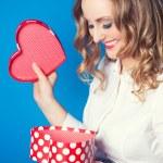 Woman holding heart-shaped box — Stock Photo #40037205