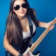 Beautiful young woman with guitar — Stock Photo