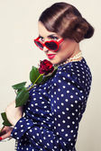 Retro woman with red rose and glasses — Stock Photo