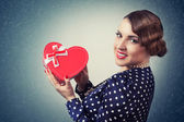 Woman with heart-shaped box — Stock Photo