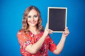 Woman with blackboard — Stock Photo
