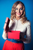 Woman with a gift box — Stock Photo