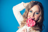 Beautiful young woman with lollipop — Stock Photo
