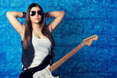 Woman in sunglasses with guitar — Stock Photo