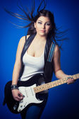 Brunette lady with guitar — Stock Photo