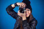 Smiling female in hat taking picture — Stock Photo