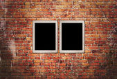 Black frames on brick wall  — Stock Photo