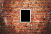 Black frame on brick wall  — Stock Photo