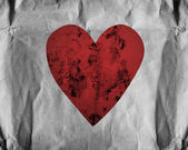Red heart on paper — Stockfoto