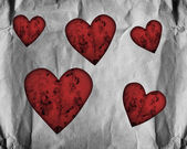 Red hearts on paper — Stock Photo