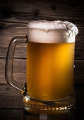 Glass beer on wood background  — Stock Photo