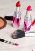 Various Cosmetics on wooden table — Stock Photo
