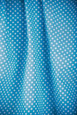 Blue polka dot fabric — Stock Photo