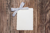 Blank paper sheet with bow — Stock Photo