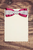 Blank paper sheet with pink bow — Stock Photo