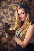 Woman with jewelry chest — Stock Photo