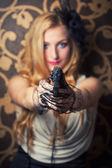 Woman holding  revolver — Photo