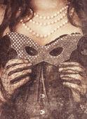 Vrouw bedrijf masker — Stockfoto