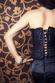 Woman wearing corset — Stockfoto
