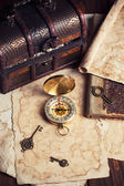 Chest, compass and map — Stockfoto