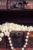 Chest with pearl necklaces — Stock Photo