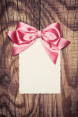 Paper sheet with bow — Foto de Stock
