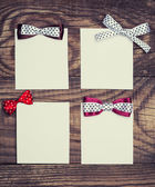 Paper sheets with bows — Stockfoto