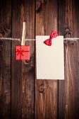 Paper sheet with bow — Stockfoto