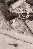 Treasure chest, compass and old map — Стоковое фото