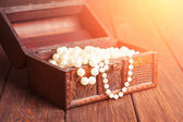 Old treasure chest with pearl necklaces — Stock Photo