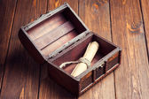 Old paper roll inside treasure chest — Stok fotoğraf