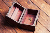 Vintage key inside old treasure chest — ストック写真